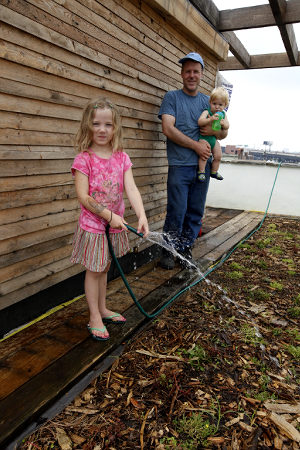 green builder with family on green roof in brooklyn