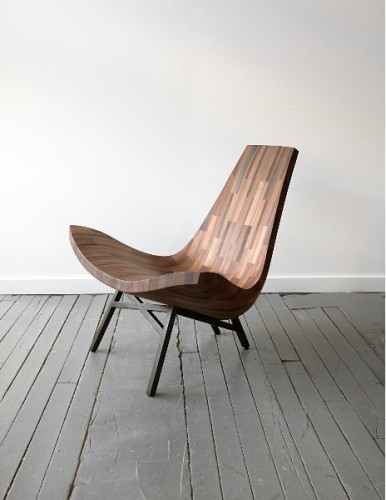 a sleek wooden chair made from salvaged materials