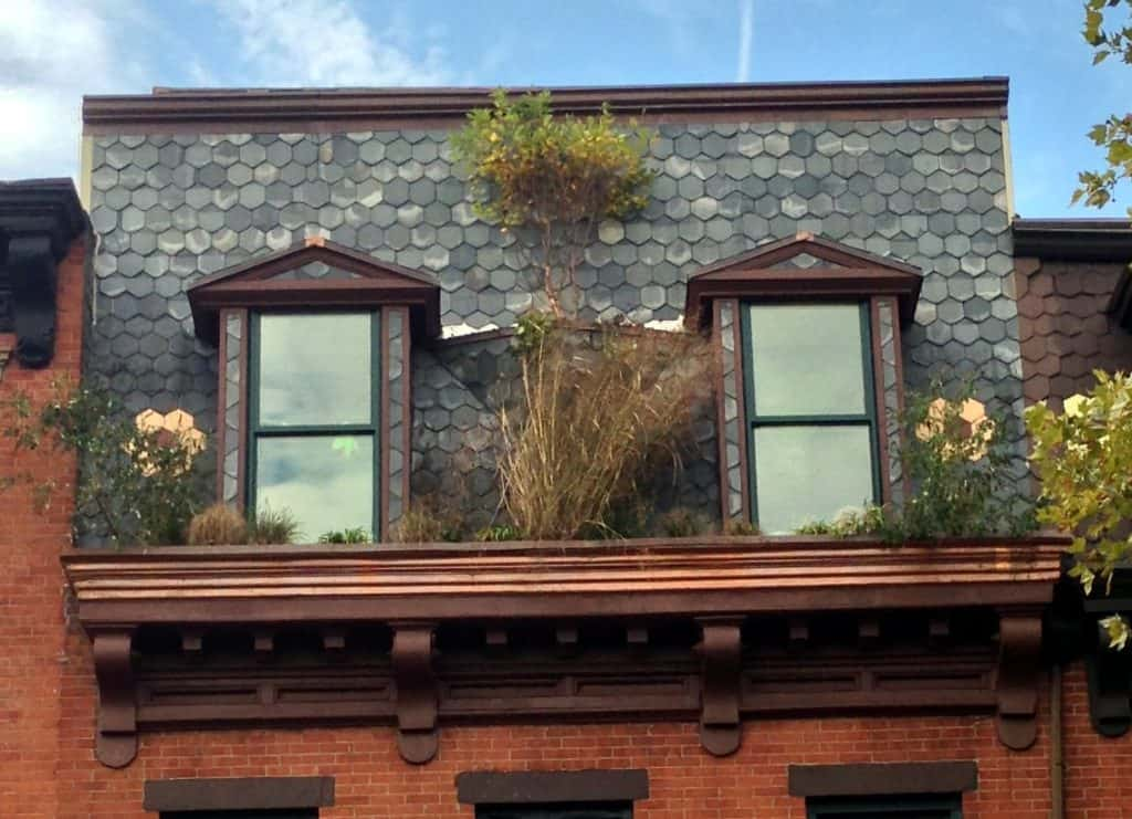 The Eco Brooklyn show house combines original details like the slate and painted flowers with new details like the planters.