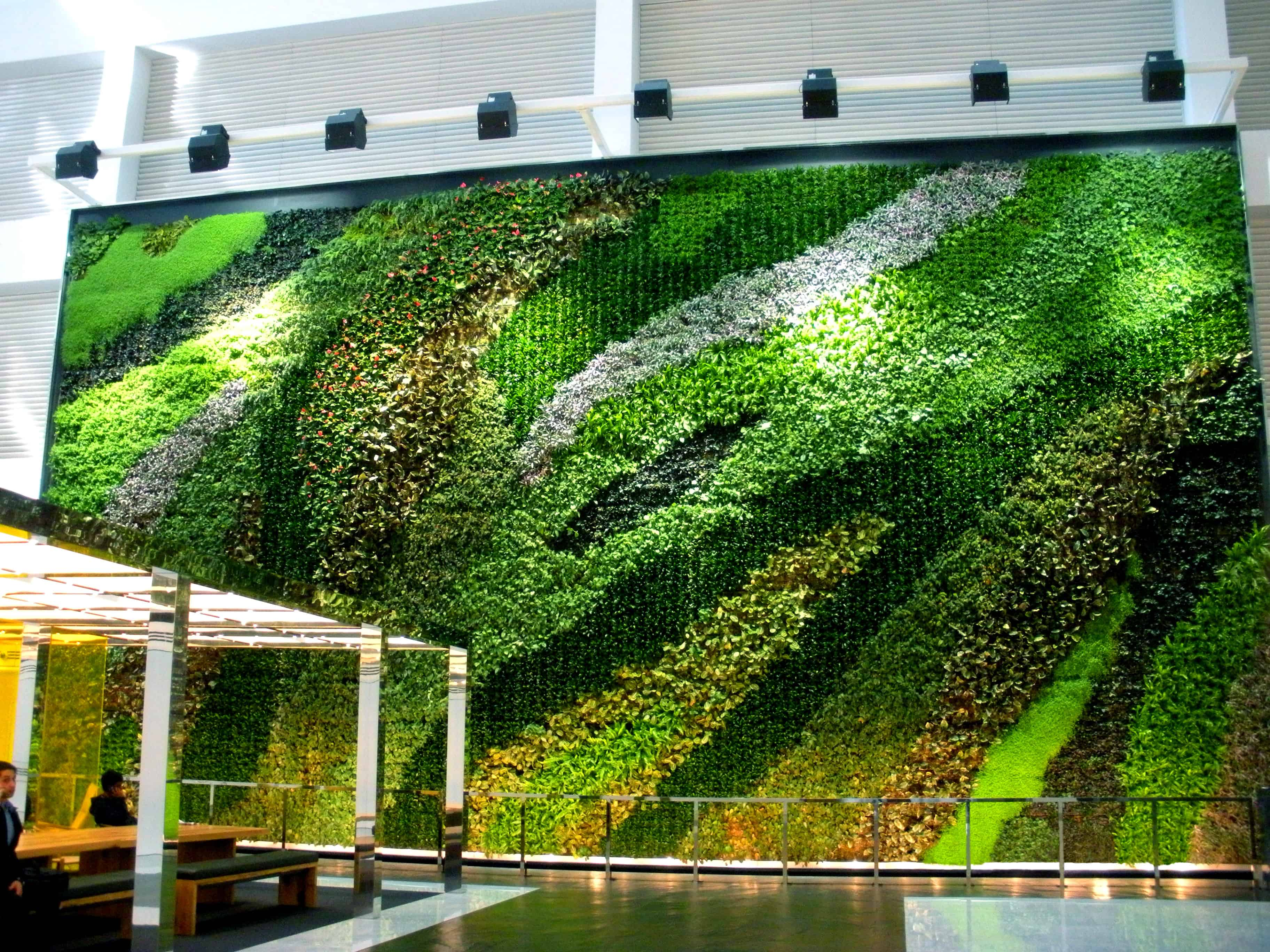 informal green wall indoors. This Living Wall Has Plants Arranged In Informal Shapes Where The Are Natural. Green Indoors R